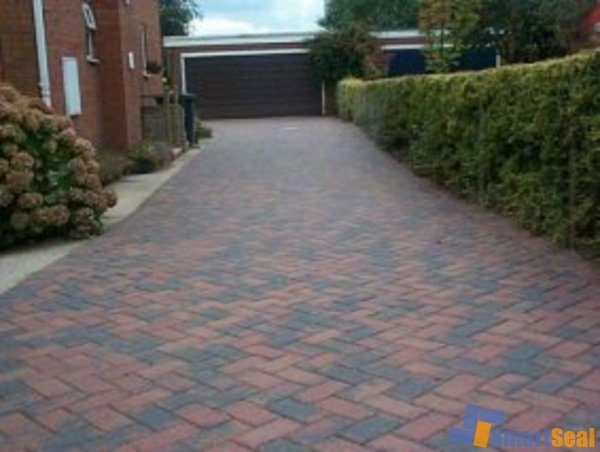 Driveway after cleaning and sealing