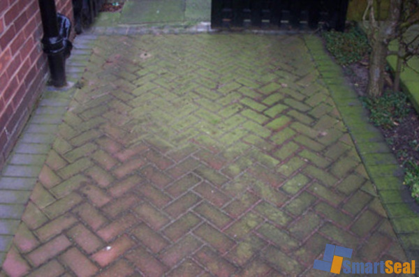 Area of block paving needing cleaning